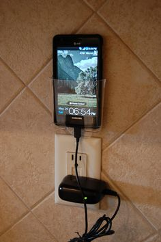 cell phone holder - Command Hooks brand.  Keep the cords neat and organized and everything off the counters.