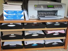 Sew Many Ways... shared this idea: Printer stand (old tv stand) each tray below holds different type paper.