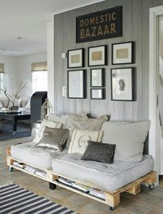 love the arrangement of frames on the wall, plus the assortment of throw pillows. pulled together, but eclectic.