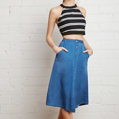 """Buttoned chambray A-line skirt A calf-length chambray skirt cut into an A-line shape with a buttoned front. Unlined, woven. 100% viscose. Machine wash cold. 26.5 full length and 27"""" waist Forever 21 Skirts A-Line or Full"""