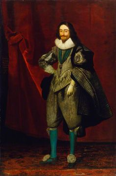 A portrait of King Charles I wearing a ruff, a grey doublet (close fitting, buttoned jacket), gauntlet gloves, knee-length breeches and turquoise-blue stockings. An inscription on the painting indicates that he was 29 at the time it was painted