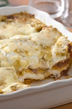 Casserole layered with pulled pork, tortillas, green chile enchilada sauce and sour cream.