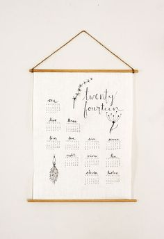 Craft up this sweet and easy to make DIY linen wall calendar to grace your walls in 2014 or give as a fabulous homemade holiday gift!