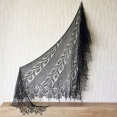 This shawl is an asymmetrical side to side triangle shawl.
