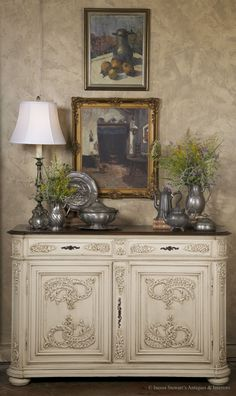 Crafted exclusively from old-growth French white oak, this handsome antique Country French buffet will defy time itself! Exquisite painted finish makes a great complement to your decor. Mitered corners add visual appeal along with the finely executed hand-carved embellishment across the entire facade. Circa 1870's.