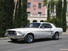 I used to have this car exactly. White with red interior. 1967 Ford Mustang - still very distraught that Daddy sold it.  :(
