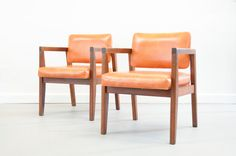 Walnut and Orange Naugahyde Armchairs in the by TheCactiCollective