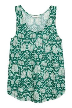 Patterned jersey vest top: CONSCIOUS. Gently flared vest top in airy, patterned jersey made from recycled polyester with a rounded hem.