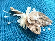 This listing is for 9 handmade rustic burlap boutonnières for a groom and groomsmen. They are embellished with burlap leaves, one cream white cotton lace flower and wired white glass pearl beads. The stems are carefully wrapped in burlap and decorated with a bow of cream satin ribbon.  Perfect touch for a rustic or woodland inspired wedding.  The length of each boutonnières is 12 cm approximately.  2 white floral pins attached to the each boutonnière.  ✉Please contact us if you need more…