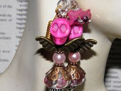Day of the Dead Angel Earrings with Pink Sugar Skulls, Copper Angel Wings, Handmade Pink and White Lampwork Swirl Glass Beads, Pink Pearls, and Pastel Pink Frosted Lucite Flowers with Swarovski Crystals. Original One of a Kind Jewelry by MelancholyMind, $14.99