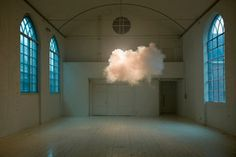 """Artist Berndnaut Smilde can create little clouds indoors without the use of a magic weather-controlling device. Unless a thermostat, humidifier, and fog machine count, in which case he does. *cranking thermostat* It's gonna be a scorcher today! Impressive Berndnaut, but I've been making indoor clouds for years now. """"Prove it."""" *wafting* Give it a second -- you'll smell it.    Hit the jump for several more clouds on brief display (they don't last long!) at a gallery."""