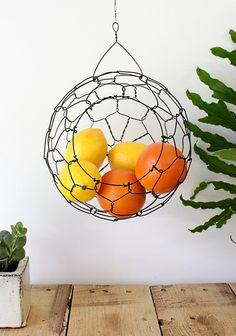 This listing is for my medium size sphere basket. I also make a large and a small.These beautiful hanging baskets are great for fruit or vegetables. You may have other ideas for them. Hanging Fruit Baskets, Hanging Wire Basket, Wire Baskets, Wire Fruit Basket, Diy Kitchen, Kitchen Storage, Kitchen Decor, Kitchen Design, Kitchen Hacks