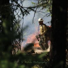 A firefighter manages a back burn at the Bridge Creek Fire last year. #fire #firefighter #wildfire
