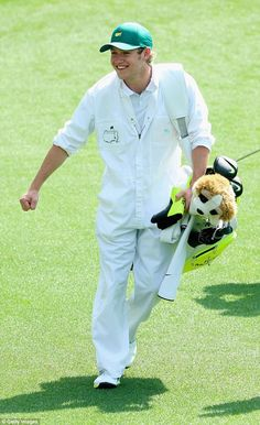 Teeing is believing! The One Direction hunk was on hand to be the Northern Irishman's caddy during the Masters Par 3 contest ahead of the 2015 Masters Tournament at Augusta National golf club