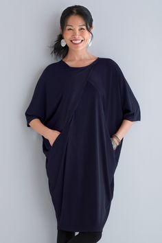 Cocoon Dress by Planet . The drama of batwing sleeves combines with architectural shaping to create a singular piece with an eye-catching silhouette. The fluid drape of wrinkle-free matte jersey makes it supremely comfortable, too.