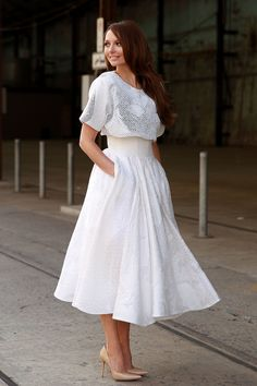 Best #streetstyle @ 2014 Sydney Fashion Week | a romantic all-white look featuring a loose fit top and full skirt paired with nude pumps