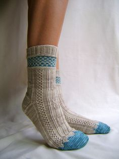 Stranding + lace = this will be my first attempt at socks. So beautiful! #ravelry #knitting