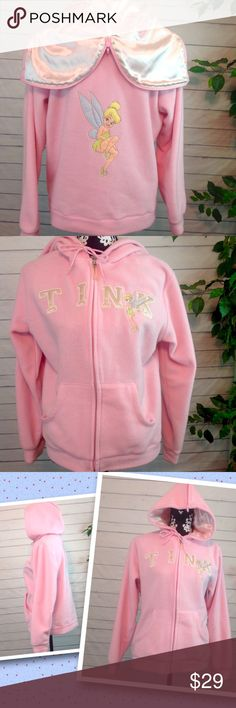 """Disney Tinkerbell Pink Hoodie Size Medium Crazy cute!  Like new condition! Disney Tinkerbell hoodie!  Embroidered, appliqué front & back. Hood unzips in middle, turning into a cape / collar, revealing """"feisty"""" on a satin look lining. Tinkerbell fan?  You gotta have this! Medium. Zip front w/ pockets. 100% polyester.  Bust 22"""" across.  Bottom 20"""" acrossPlease ask all questions before you purchase! I'm happy to help! Sorry, no trades or holds Please, no lowball offers Please use Offer Button…"""