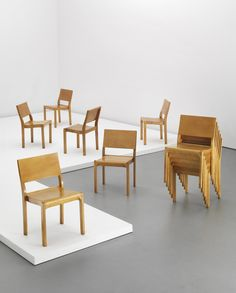 """ALVAR AALTO Set of twelve stacking chairs, model no. 611, designed 1929  Laminated birch plywood, birch. Each: 31 3/8 in. (79.7 cm.) high Manufactured by Artek, Finland/Sweden. Underside of five chairs stamped with """"AALTO DESIGN/ARTEK,"""" two chairs with """"AALTO DESIGN/ARTEK/ Made In Sweden,"""" and one chair with """"ARTEK/aalto-design/MADE IN FINLAND"""" (12)."""
