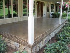"""Front or Back Porch Idea..."" A base of Desert Sand and an overspray of Mocha with a  Mocha border engraved to look like brick. Foundation with a stone finish... #concretepatio"