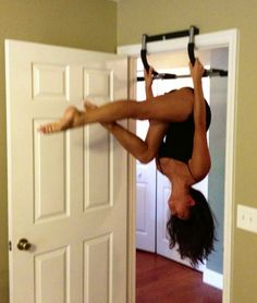 Practice inverting on a door hanging pull-up bar