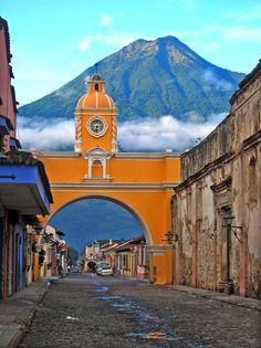 The famous archway of the Santa Catalina convent in Antigua, Guatemala with Volcano Agua seen in the background.