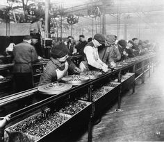 Workers of Henry Ford costuming: 99 years ago, Henry Ford announced a minimum wage of $5 for employees.     It shocked many, since the standard wage at the time for factory workers was about half that, but it helped Ford decrease turnover and increase morale.