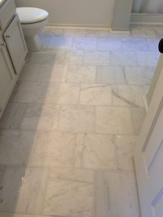 Our Style Challenge blogger Bryn used square cararra marble floor tiles to update the floors in her master bath #tile