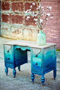 """""""Oh, this vanity. This vanity had a rough life before it found us! We used Salt Wash mixed with Coastal Blue, Linen and Seagull/Driftwood mix for the first layer. For the second layer, we put 12 (TWELVE!!!!) different colors on a palate and mixed our brush around without fully mixing the colors together which gave this gal an ombre look. The colors used were: Coastal Blue, Klein Blue, Stillwater Blue, Summertime Blue, Fjord Blue, Halcyon Blue, Patina Green, Persian Blue, Millstone, ..."""