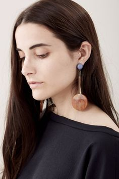 Shop till you drop, they say. Well, all we're thinking about is drop earrings. From AGMES to Ora-C to Rachel Comey, we've got a pair for you. These Rachel Comey Jo earrings are too beautiful. We love the color combination of tawny and marble blue, it really makes them pop. A perfect piece to spice up any outfit.