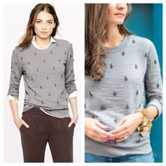 J.Crew/Painted jeweled sweatshirt A lightweight laid-back sweatshirt gets a luxe update, courtesy of a jeweled motif across the front and sleeves. It's not just any jeweled motif, though—the stones are actually painted by hand and then hand applied in a cool graphic layout. Cotton. Hand wash. Import. J. Crew Sweaters Crew & Scoop Necks