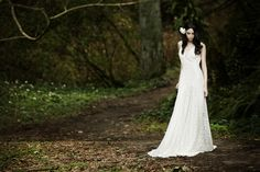 All lace bridal gown with a plunging v-neck, fitted bodice and flowing skirt.