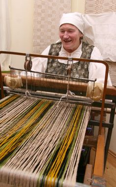 This woman is weaving Lithuanian folk costumes and various textile products made of linen, wool, cotton.