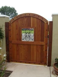 Image result for wood fence with iron accent