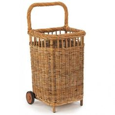 "106 Days of Summer, Day 6: Update Your Basket Brigade! The new picnic basket? A hamper for beach towels? A fresh take on a beach ""wagon?"" Whatever you use the pretty wicker French Market Cart for, she'll deliver. - Coastal Living"