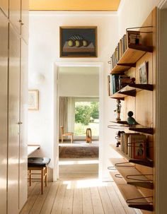 Light, wood, nice storage, and a little frame above the door... On the left, i like the ottoman and the desk.