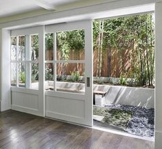 These doors are amazing. Finally a modern response to the age old 'sliding glass doors.' - Click image to find more Home Decor Pinterest pins