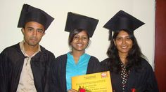 Three students with their certificates on their Convocation ceremony