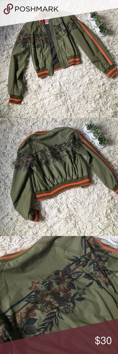 Free People Bomber Jacket Olive green with bright orange accents. Features a hibiscus flower design on front and back. Zipper closures with cotton collar and sleeve details. Has pockets. Very gently worn, excellent condition. Free People Jackets & Coats Utility Jackets
