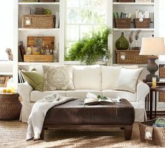 Like this neutral living room and green pillow from Pottery Barn