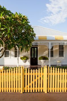 yellow fence and awnings