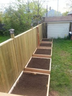 Raised beds along fence (4x4 ceader beds)