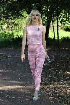 GracefullyVintage in a pink top and pants