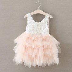 A beautiful dress with a tiered long full tulle skirt and delicate lace details. The perfect piece for a photo shoot or any special occasion. Runs large. Size (cm) 12M 18M 2T 3T 4T 5T Bust 22 25 27 29