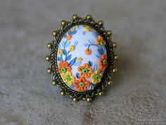 Check out this item in my Etsy shop https://www.etsy.com/listing/238205774/polymer-clay-floral-embroidery-ring-in