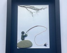 This Sticks and Stones Gallery original abstract pebble art gift is perfect for your fly fishermen or women. The stone art fly fishing design is a one of a kind gift and encompasses the peace and serenity of a day fishing from the shore. The beach stones enhance the unique nautical feel. This pebble art design oozes charm and is a really unique gift. We love to fly fish and have tried to portray the intricate nuances we have discovered in this original design. Weve also tied a fly we use…