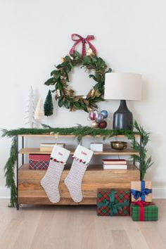 I gave our entryway a festive touch. Here are my 7 simple tips to style a holiday entry like adding wrapped gifts, garland, and a bowl of ornaments! White Built Ins, Bedroom Built Ins, Diy Playbook, Neutral Paint Colors, Board And Batten, Floating, Hanging Curtains, Christmas Decorations, Holiday Decor