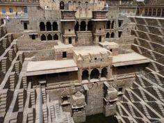 The Chand Baori is a well located in the Indian State of Rajasthan and was built in the 10th century as a solution to the dry region's water supply issues. This architectural marvel extends 100 feet below the earth's surface, has 3,500 steps and 13 levels that descend into a deep V. According to local legend, ghosts were responsible for its construction.