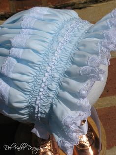 Every little Southern baby should have a smocked dress and bonnet