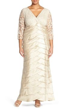 Free shipping and returns on Adrianna Papell Lace Bodice Empire Gown (Plus Size) at Nordstrom.com. Struck with a champagne shimmer, a regal gown is shaped to flatter with a surplice empire bodice of lovely embroidered lace framed with sheer-illusion sleeves. Scalloped tiers of satin form graceful lines down the column skirt.